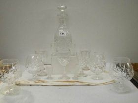 A cut glass decanter and assorted glasses.