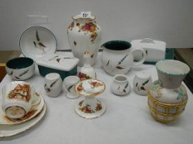 A mixed lot including vases, cheese dish, butter dish, teapot etc.