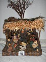 A boxed Nativity scene.