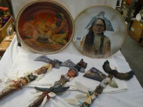 Three ornamental tomahawks and two American Indian collector's plates.