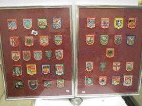 38 cloth badges in two frames, glazed.