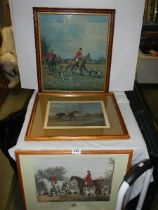 Three framed and glazed hunting scenes.