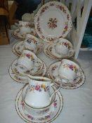 A Royal Stafford bone china tea set (missing one teacup).