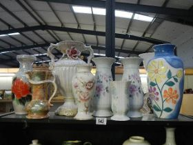Nine assorted vases.