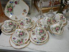 A 21 piece Roslyn china tea set.