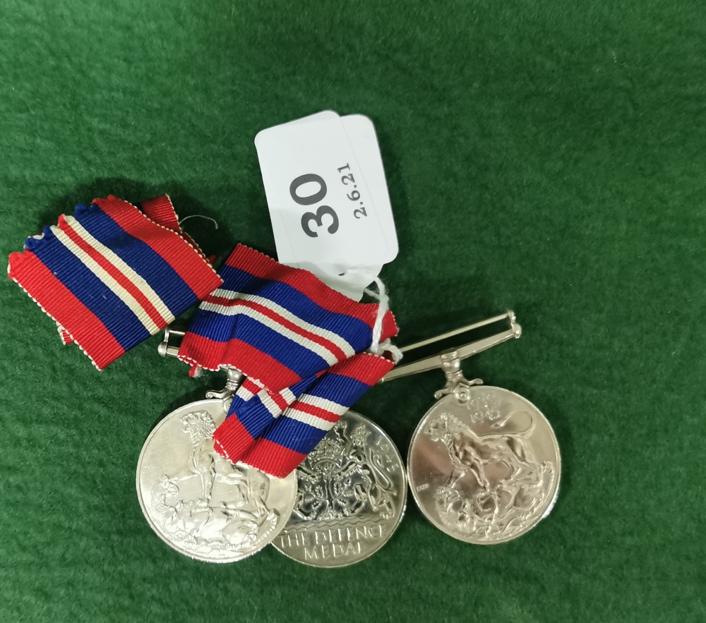 Three x World War II Gallantry Medals (2 with blue and red ribbons), including a George VI Defence - Image 2 of 2