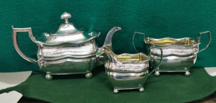 Three Piece Irish Georgian Silver Tea Service, of large proportions, dated 1838, comprising of a