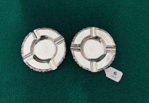 A matching pair of Irish Silver Ashtrays, Celtic design borders, Dublin 1966 by B Moynihan Ltd. 12cm