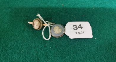 A Cameo mounted Gold Bar Brooch & a Wedgewood Pendant (stamped F & P) (2)