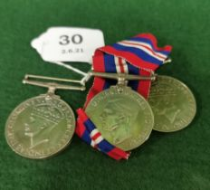 Three x World War II Gallantry Medals (2 with blue and red ribbons), including a George VI Defence