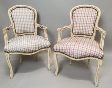 Near pair of painted pine and upholstered armchairs.