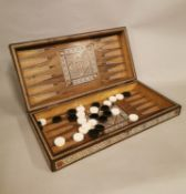 Early 20th C. backgammon games board inlaid with bone and ebony in the Anglo Indian style {