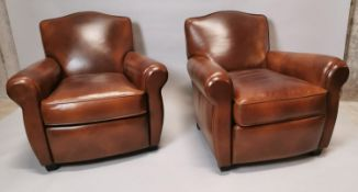 Pair of hand dyed leather club chairs.
