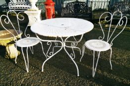 Early 20th C. metal garden table and two chairs.