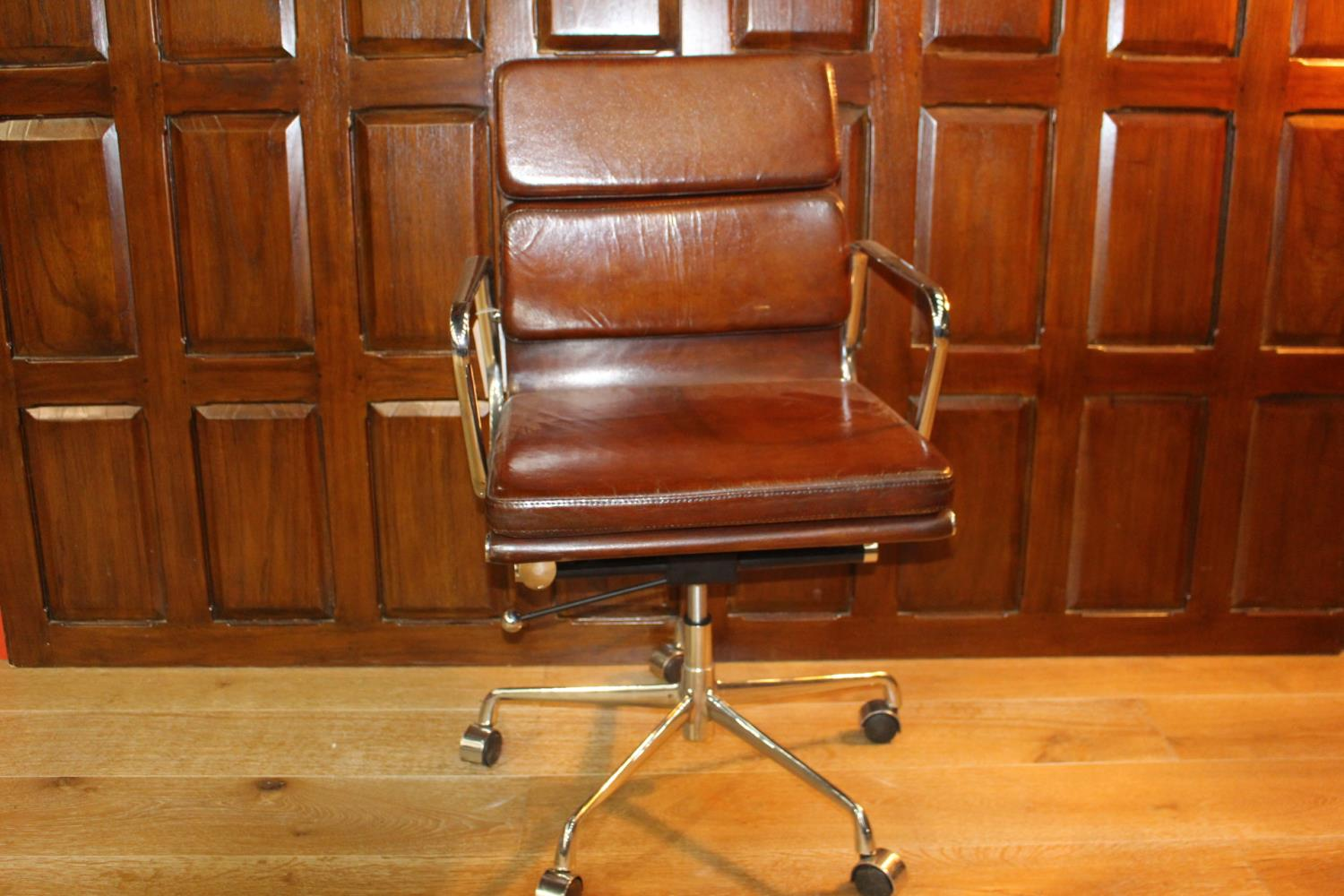 Revolving leather and chrome office chair