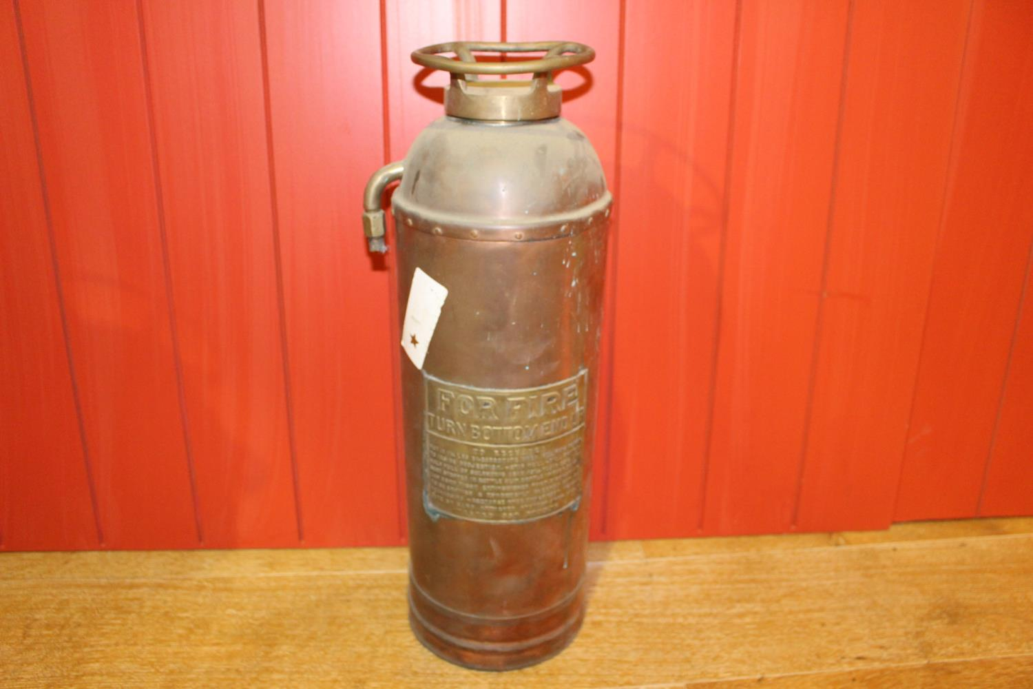 Brass fire extinguisher.