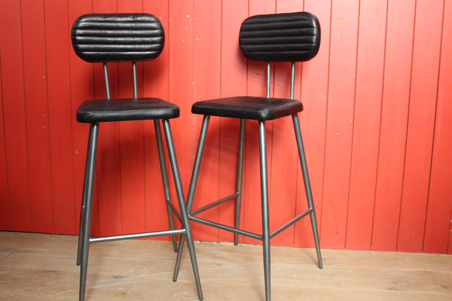 Pair of leather upholstered high back stools