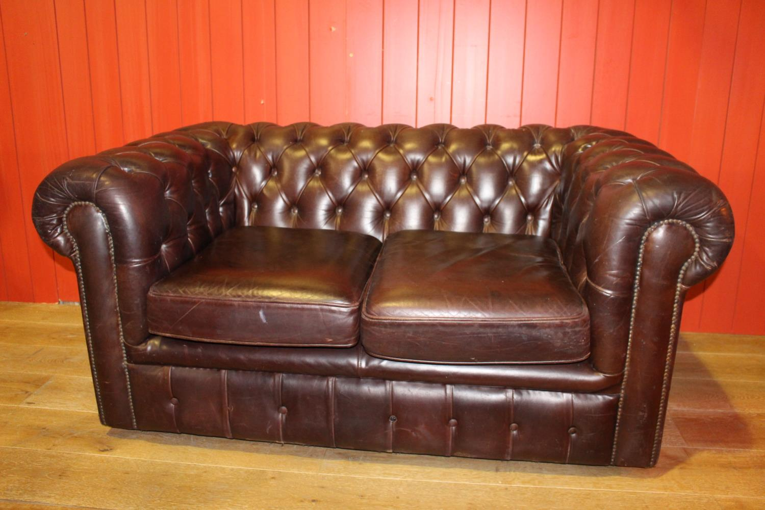 Two seater Chesterfield sofa.