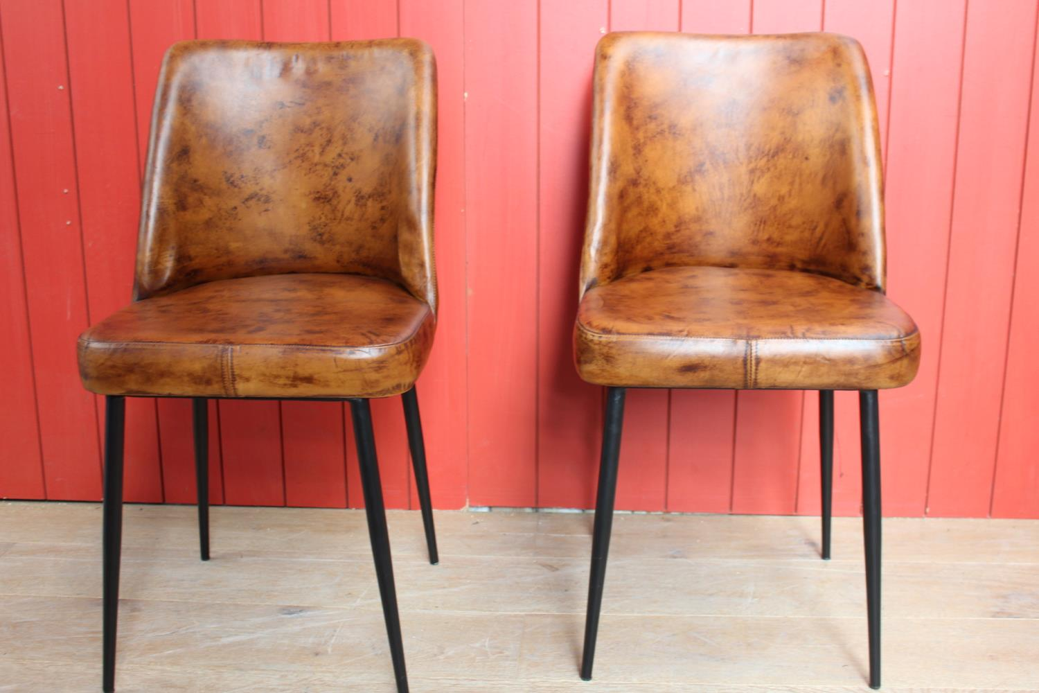 Pair of leather side chairs