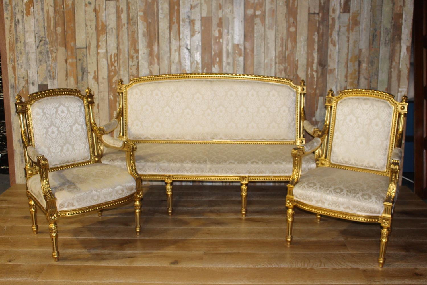 Three piece giltwood upholstered suite