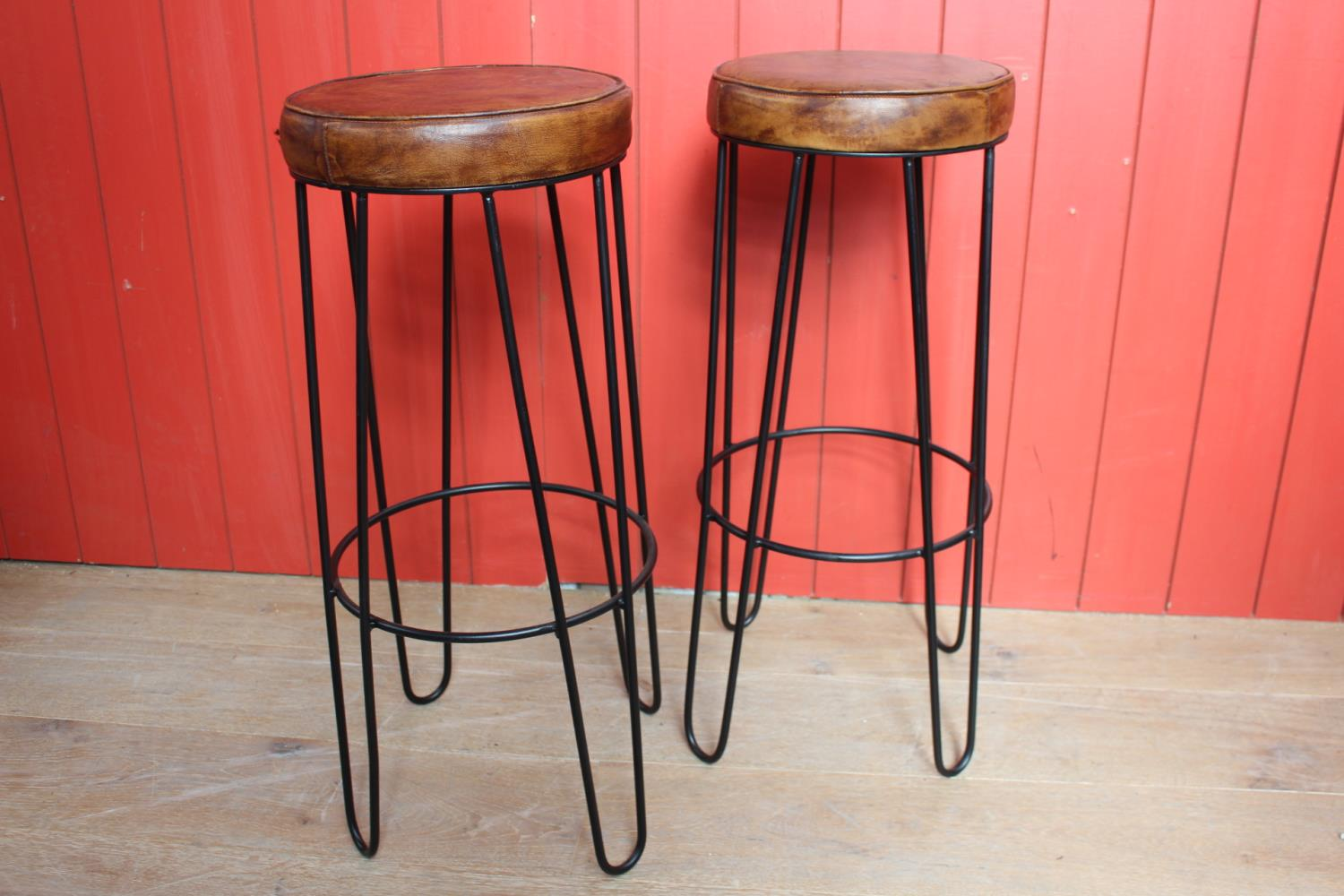 Pair of leather upholstered metal Hairpin stools