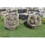 Pair of composition garden ornaments