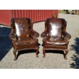 Pair of leather wing back chairs.