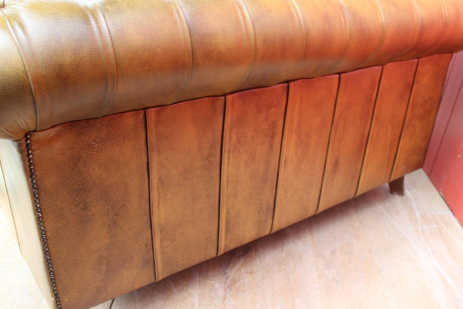 Deep buttoned leather upholstered settee. - Image 2 of 2