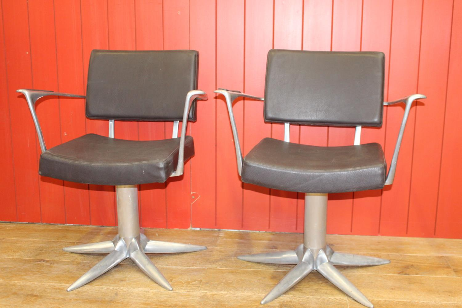 Pair of stylish swivel armchairs