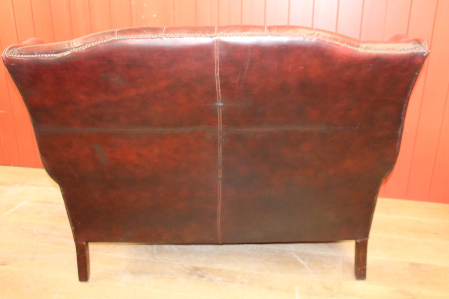 Leather Chesterfield wing backed settee. - Image 2 of 2