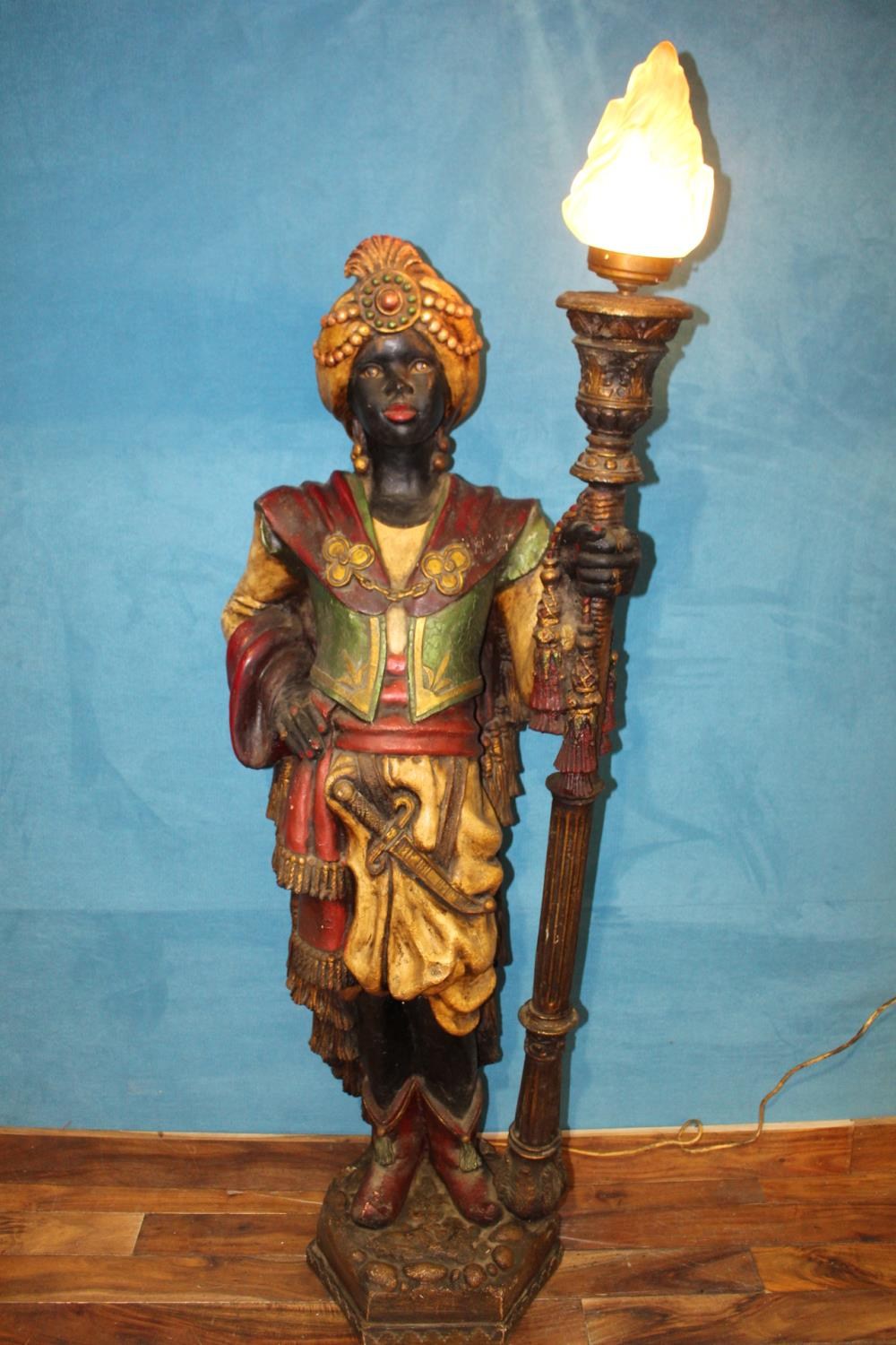 Carved wooden standard lamp