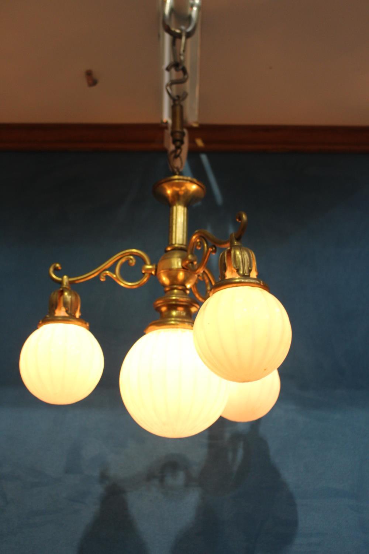 Brass three branch hanging lightshades