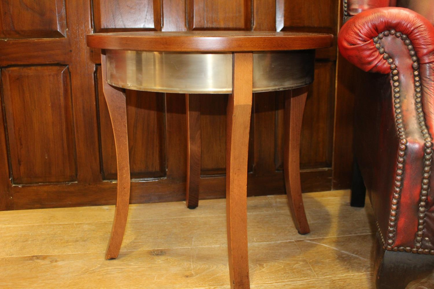 Circular brass bound wooden coffee table