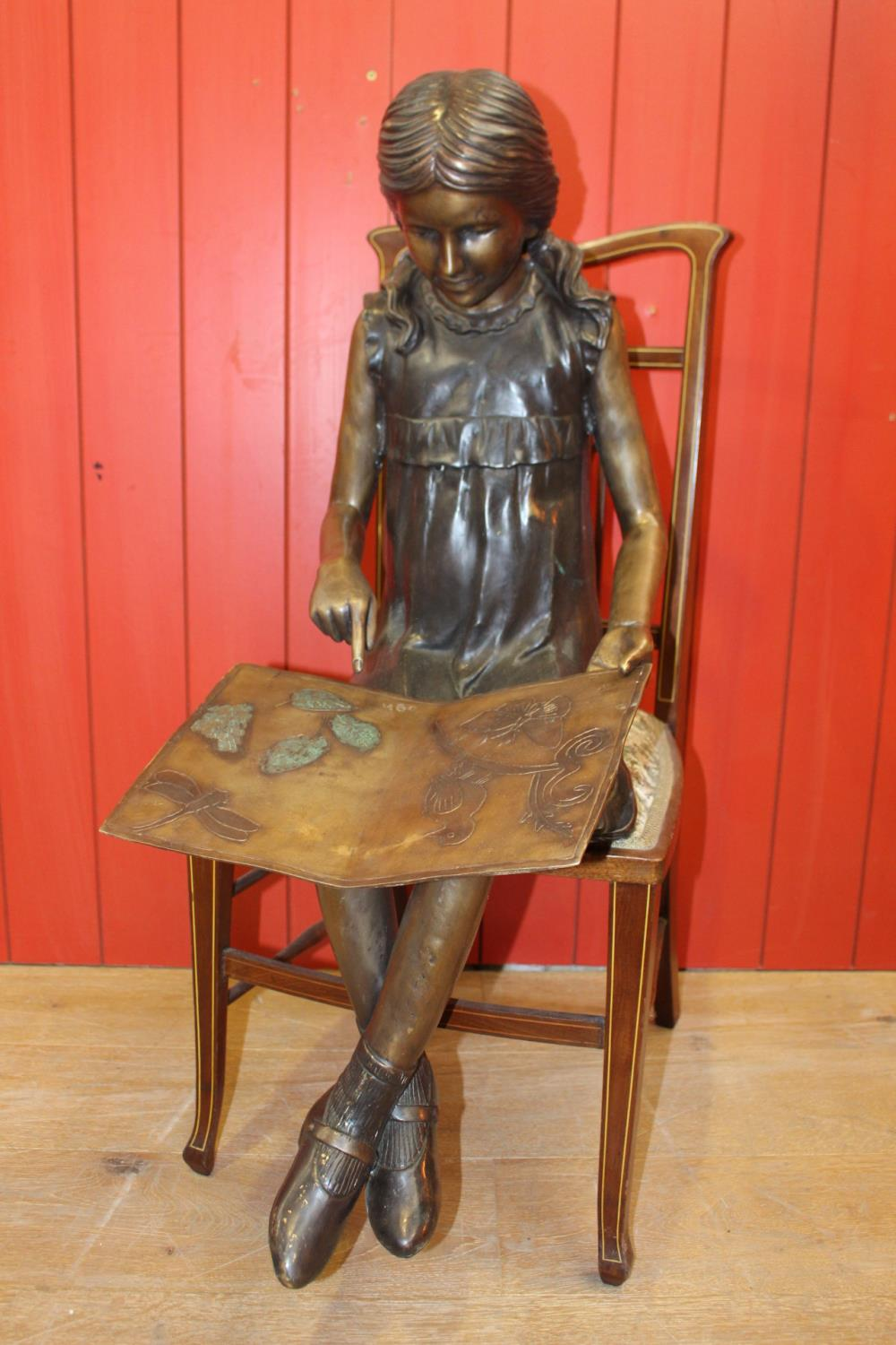Bronze figurine of a Seated Girl