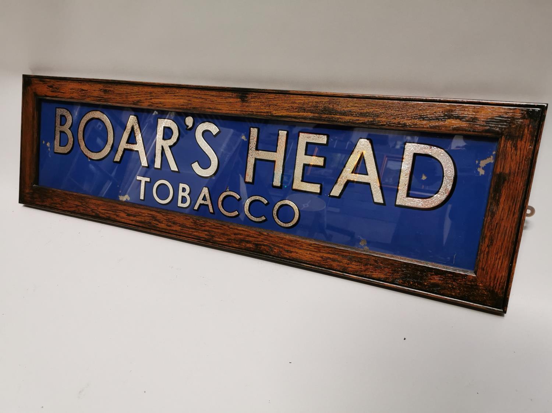 Boar's Head tobacco advertising sign.