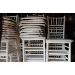 Set of forty wooden spindle backed white banqueting chairs