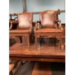 Pair of leather and oak arm chairs in the Gainsborough style.