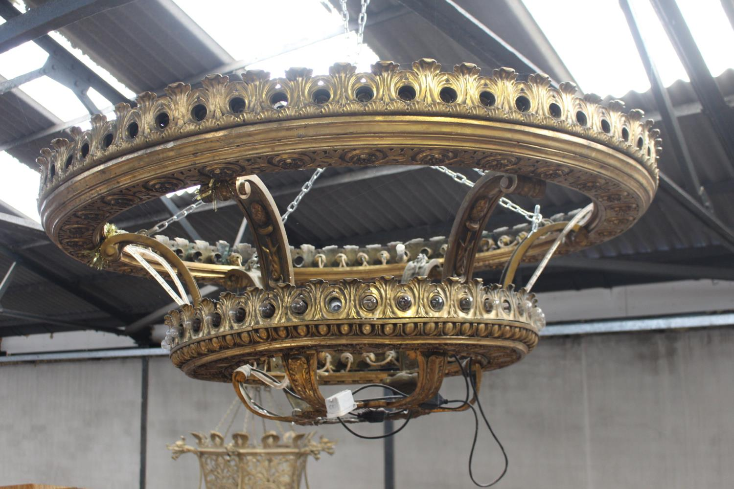 Large two tiered brass chandelier.