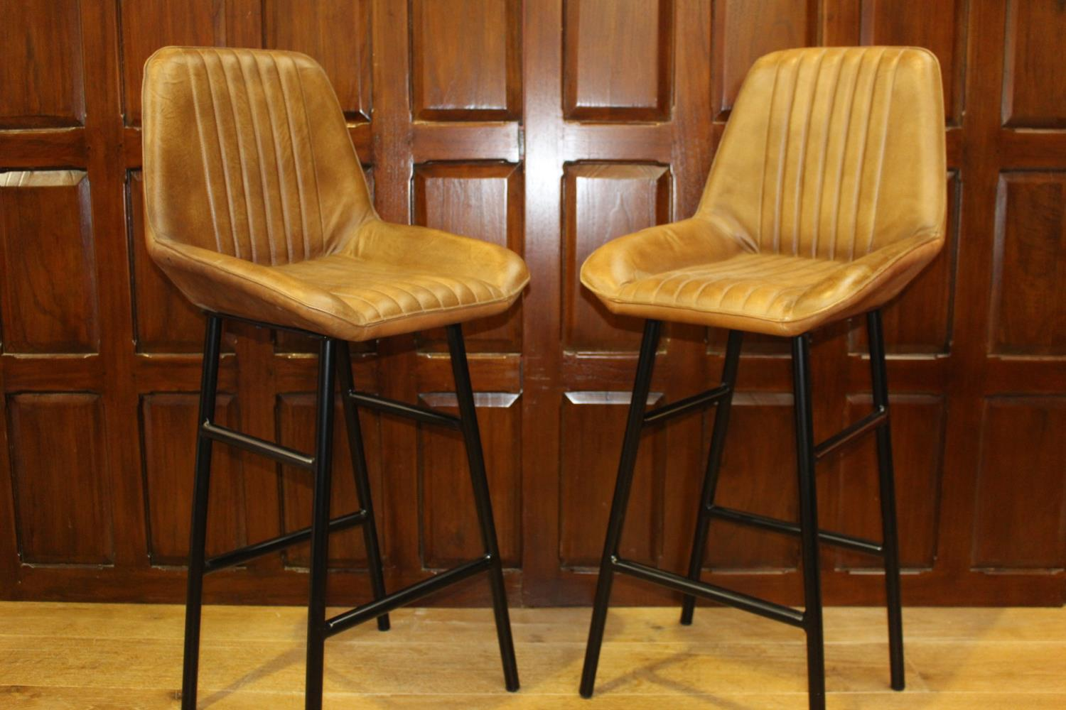 Pair of leather and metal upholstered Bakers stools
