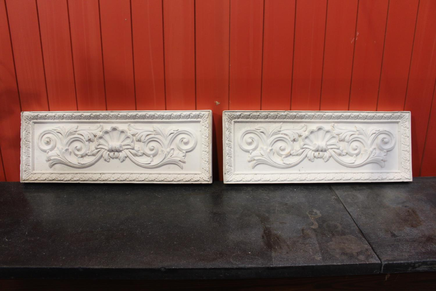 Pair of plaster moulded plaques