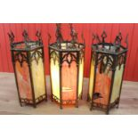 Three brass and stain glass lanterns