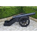 Pair of decorative cast iron models of cannons.