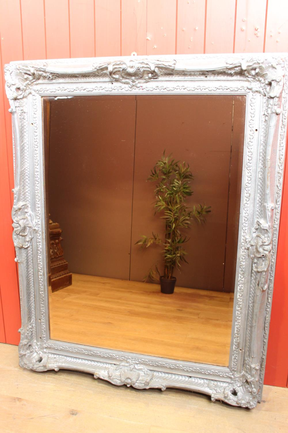 Carved silvered wall mirror