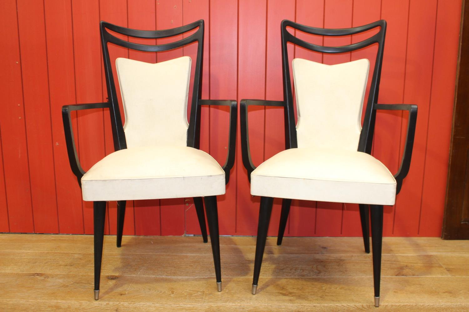 Pair of faux leather upholstered carver armchairs