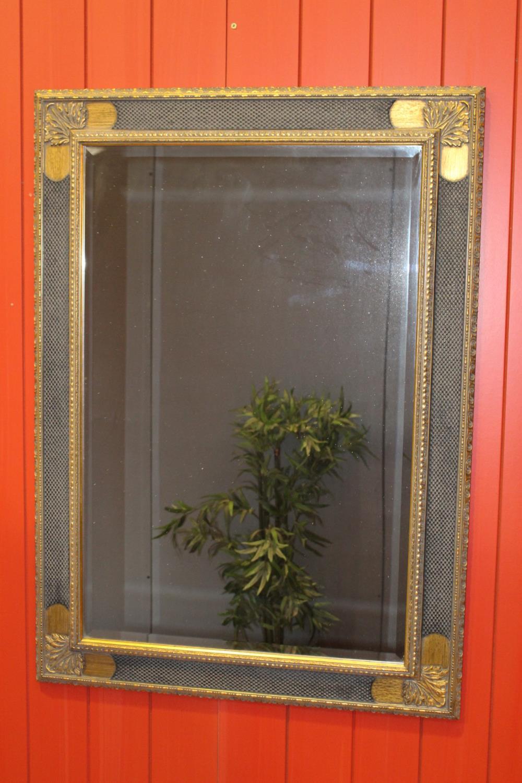 Gilt and black framed mirror