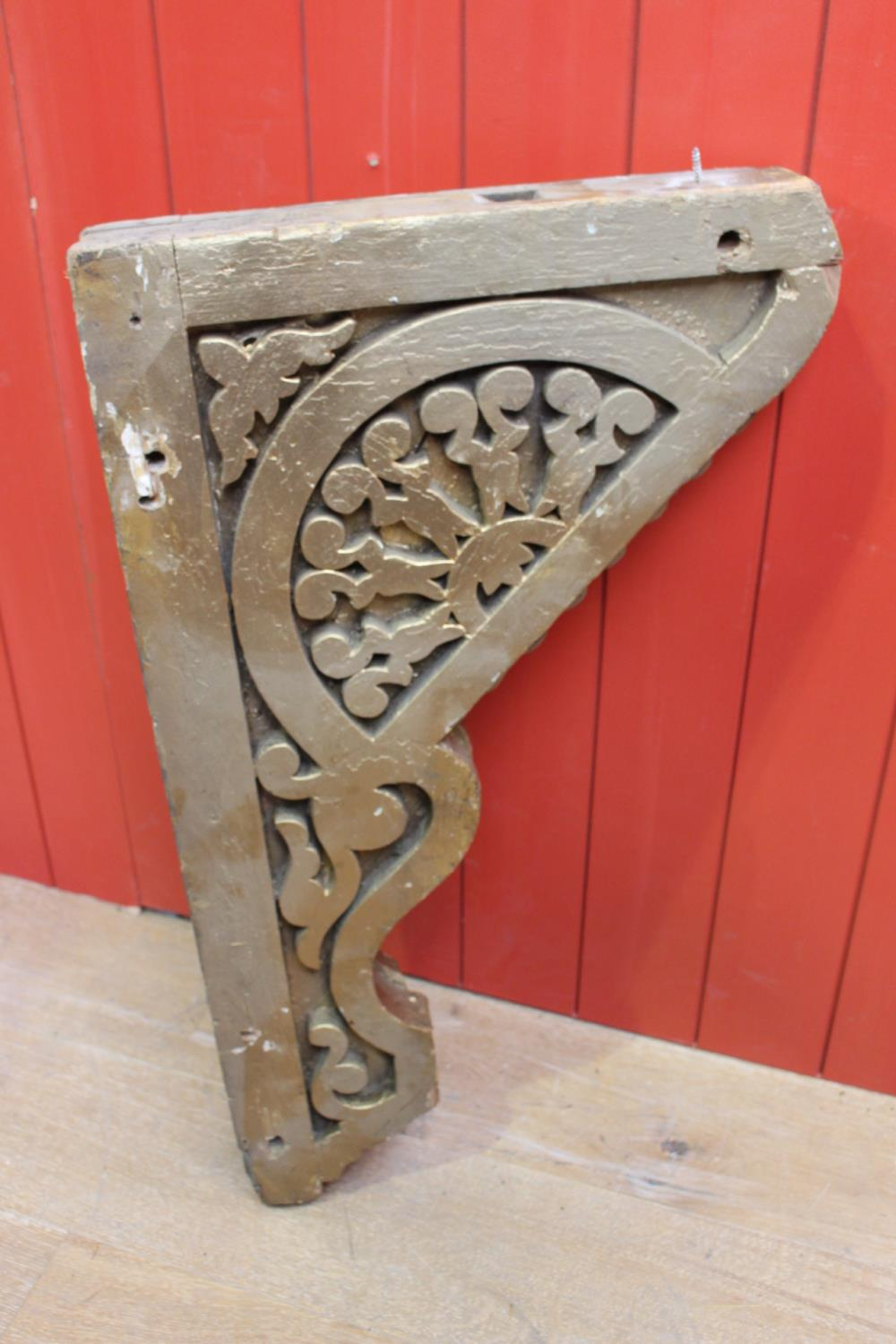 Single carved wooden corbel