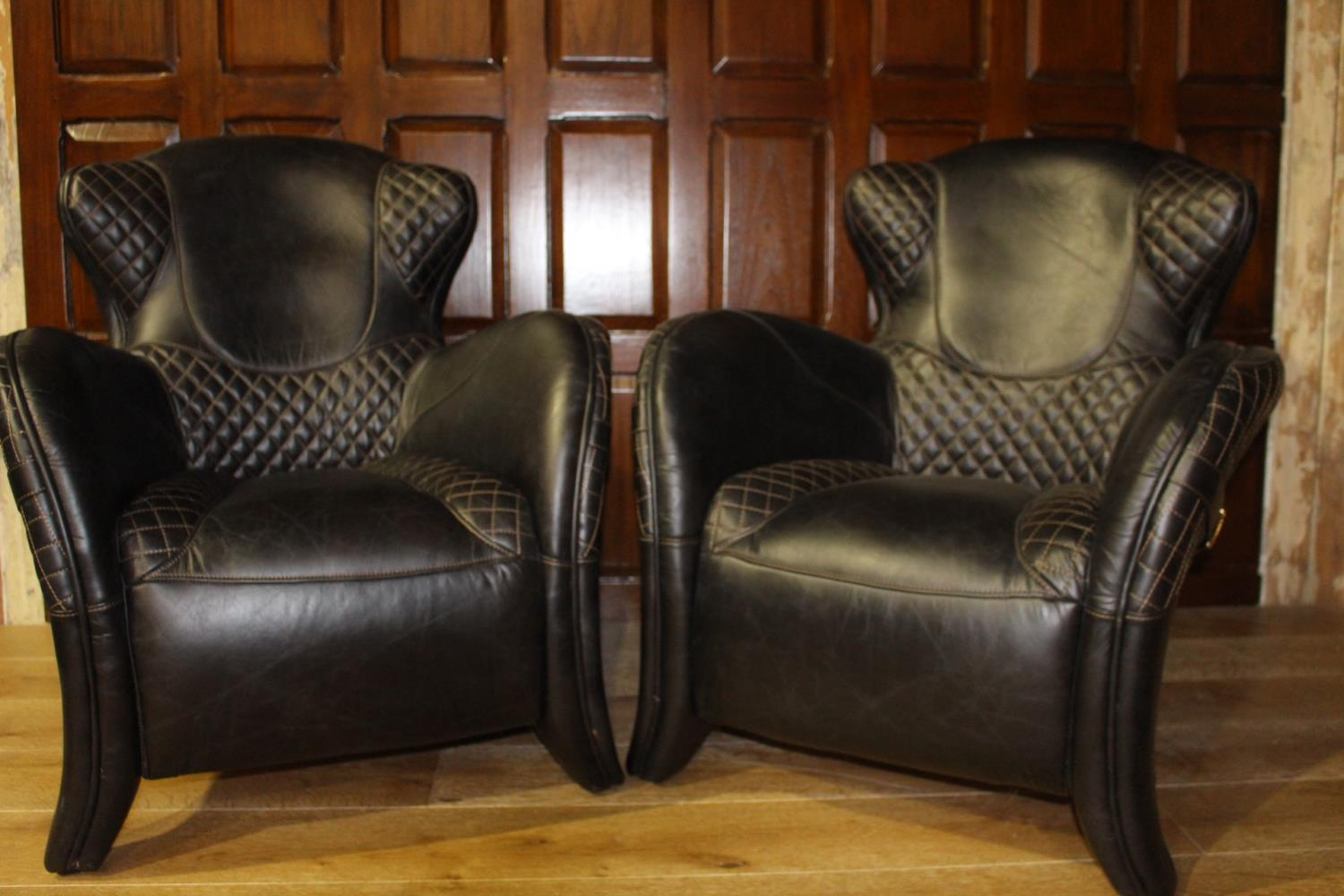 Pair of unusual leather upholstered armchairs
