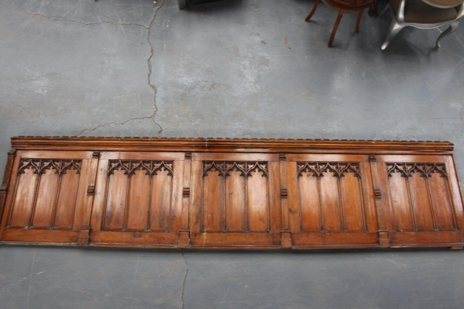 Pitch pine panel in five sections in the Gothic Style.