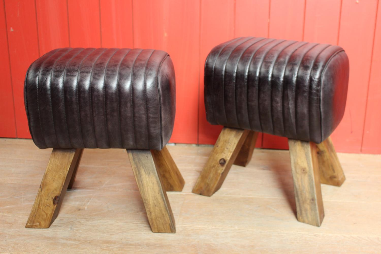Pair of leather upholstered stools
