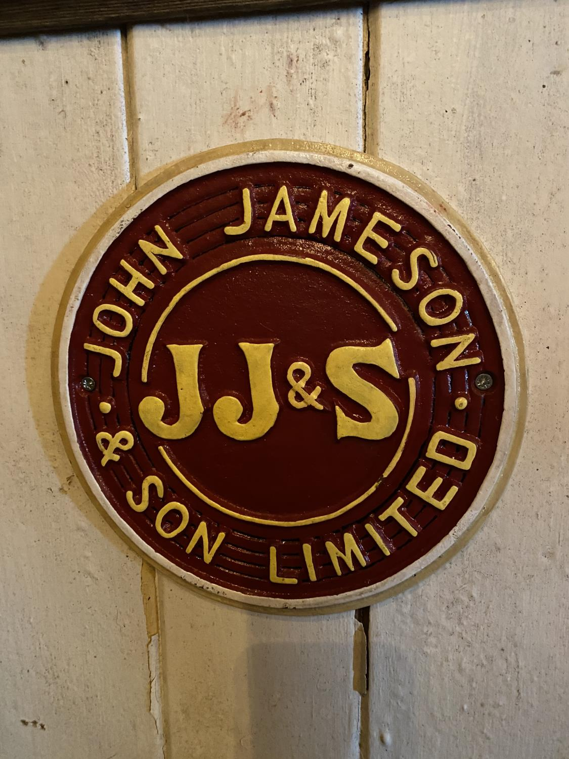 Cast iron John Jameson advertising sign.
